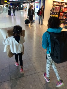 My little sherpas traveling through London Heathrow